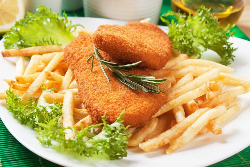 Peixes e fritadas panados do francês foto de stock royalty free