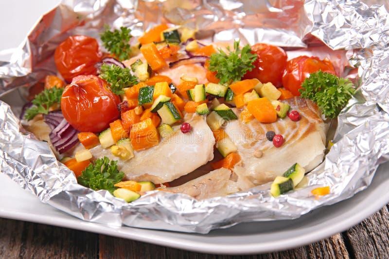 Peixes e tomate imagens de stock royalty free