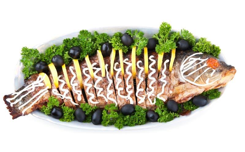 Peixes enchidos com caviar vermelho fotografia de stock royalty free