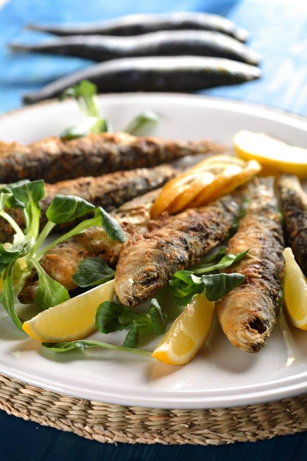 Peixes fritados saborosos imagens de stock royalty free