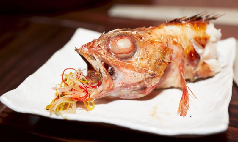 peixes Metade-comidos do BBQ fotos de stock royalty free