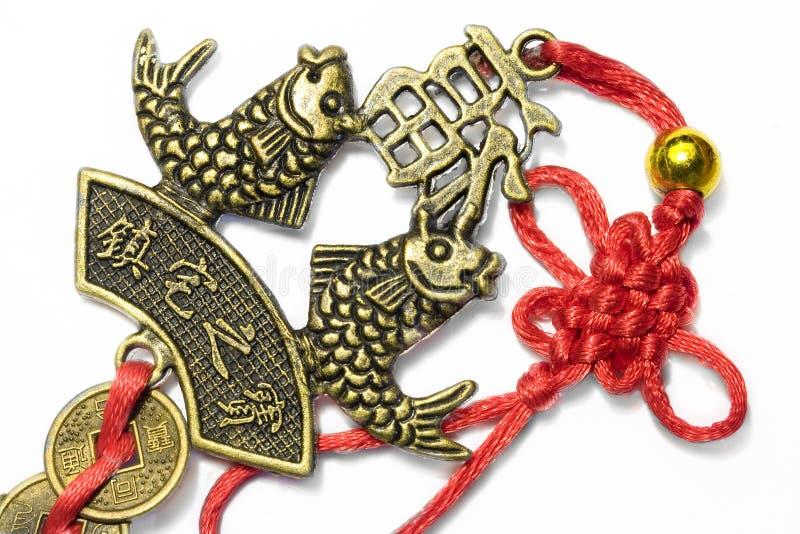 Peixes simbólicos chineses com moedas 1 do vintage fotos de stock royalty free