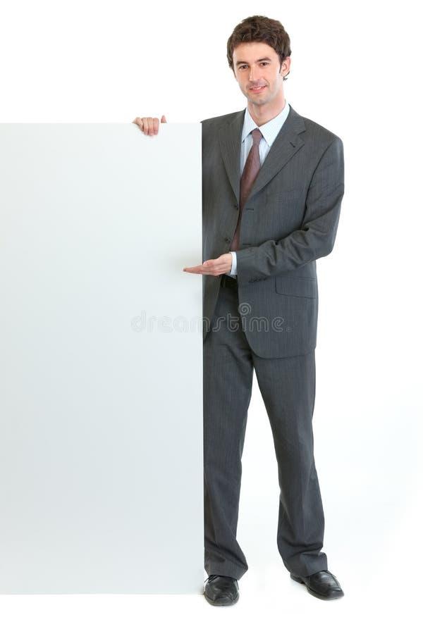 peka för blank affärsman för affischtavla modernt arkivbild