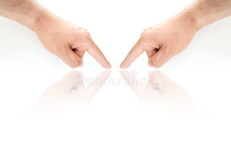 peka för händer royaltyfri bild