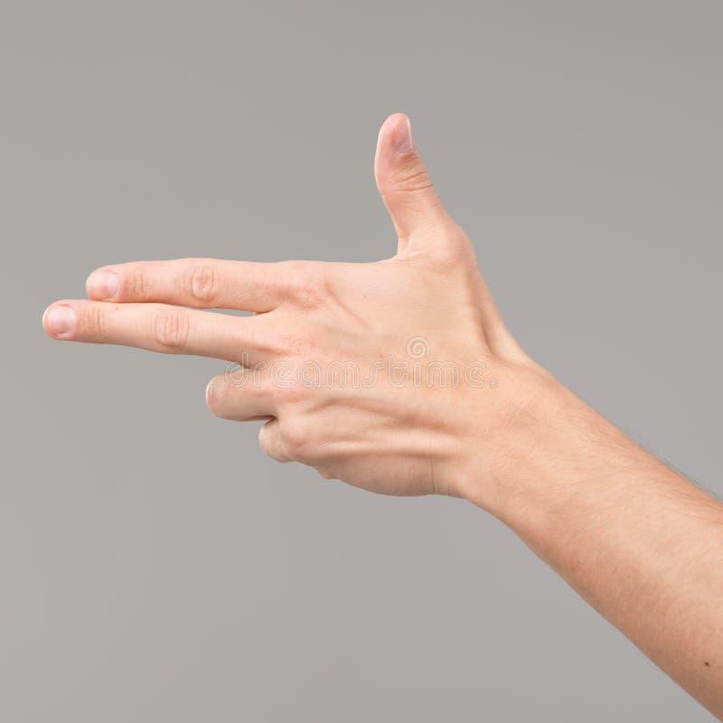 Peka gest för pistol för fingerteckenhand arkivbilder