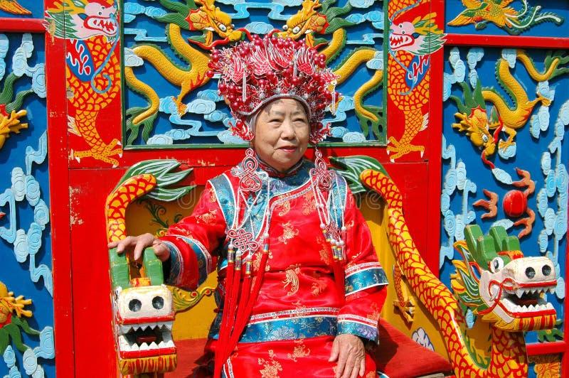 Peking, China: Frau in der zeremoniellen Robe lizenzfreies stockfoto