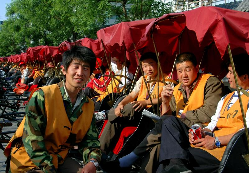 Peking, China: Hutong Pedicab Treiber stockbild