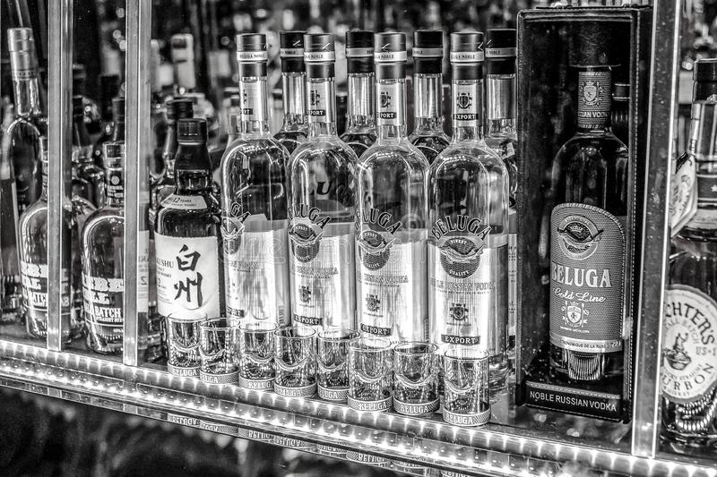 24.02.2019 Peking China - Wall with Bitters and alcohols whiskey bar counter bottles ambient tlight blurred background.  stock photos