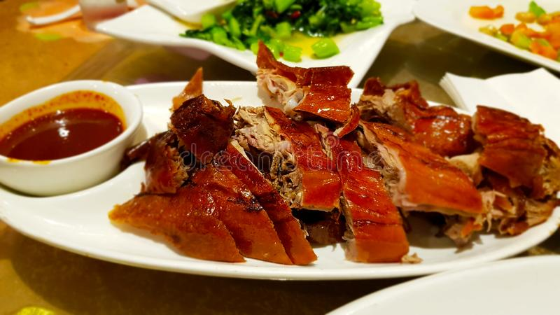 Peking duck with sauce, a typical dish of Chinese cuisine. Peking duck with sauce. Peking duck is a Chinese dish from Beijing Peking. Chinese cuisine royalty free stock photos