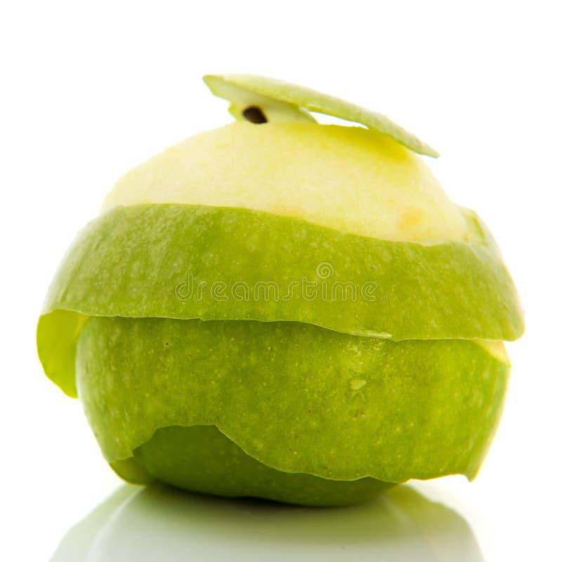 Peladura de la manzana verde imagen de archivo libre de regalías