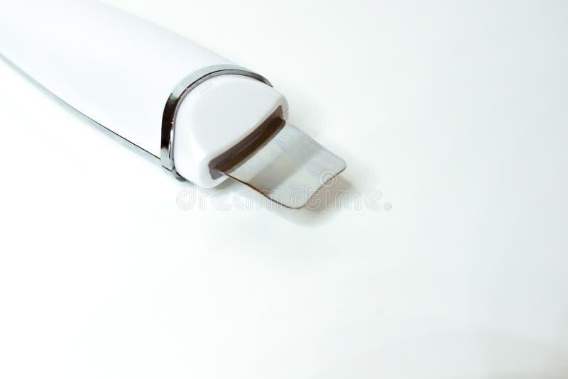 Peladura facial de la cavitación del ultrasonido Procedimiento de limpiamiento de la piel Cosmetología del hardware imagen de archivo
