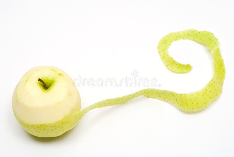 Peladura verde de la manzana fotografía de archivo