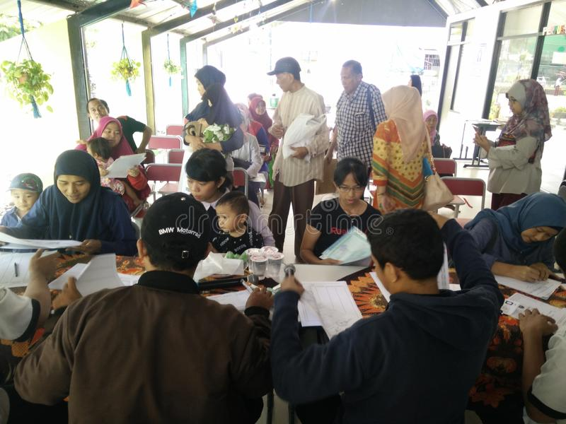 Mobile service for making a childs identity card, Jakarta, Indonesia April 2 2019. Pelayanan keliling pembuatan KIA or Kartu identitas Anak or mobile service for stock images