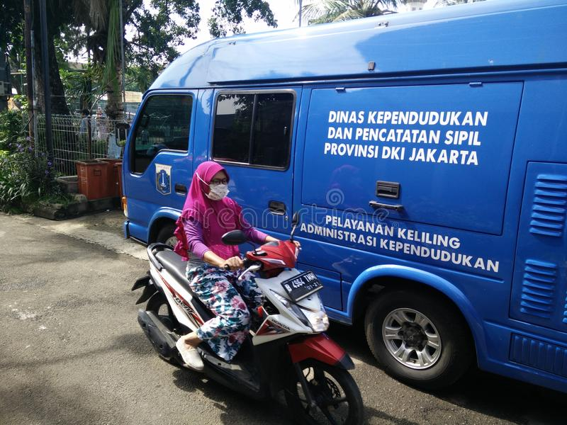 Mobile service for making a childs identity card, Jakarta, Indonesia April 2 2019. Pelayanan keliling pembuatan KIA or Kartu identitas Anak or mobile service for royalty free stock photography