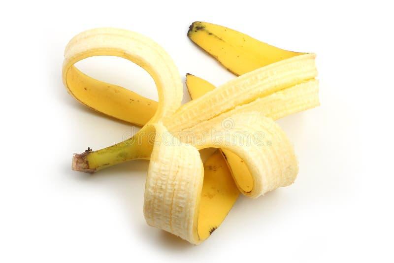 Pele de banana isolada no branco imagens de stock