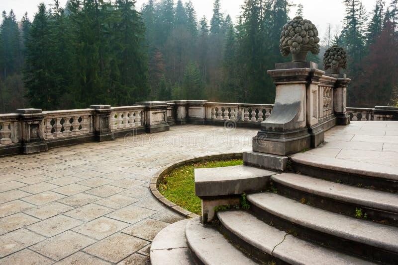 Peles castle ornamental garden balcony, Sinaia, Romania. Landmark of Carpathian mountains in Europe. View from the left stock image