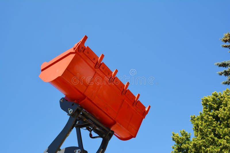 Pelle à tracteur ou chargeur rouge de bouteur photographie stock