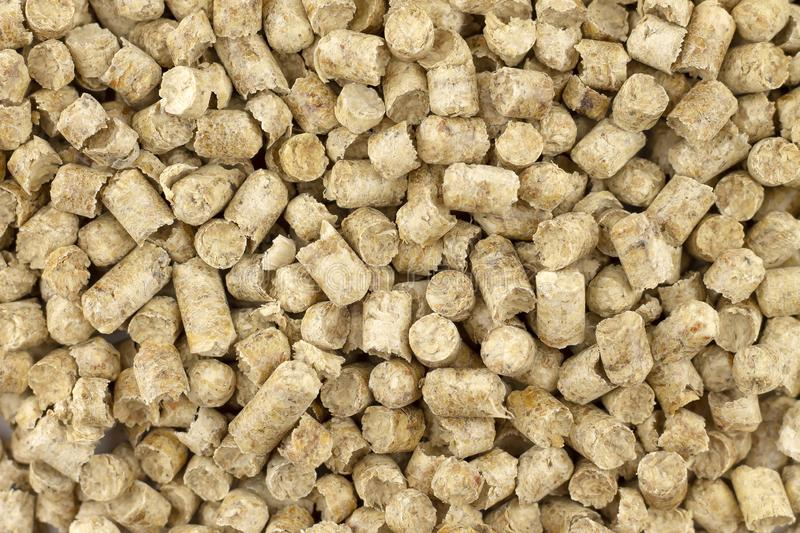 Pellets from sawdust, a background, texture stock images