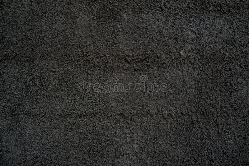 Pelliccia di cemento con la sabbia del calcestruzzo grigio scuro del solido di colore fotografia stock