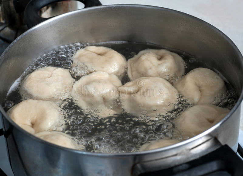 Pelmeni in boiling water royalty free stock photography