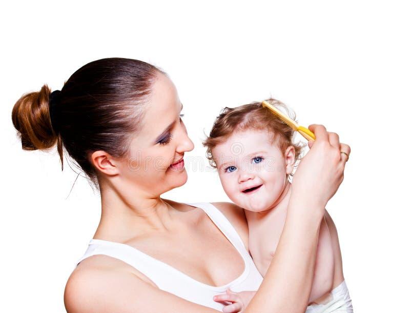 Pelo del bebé que aplica con brocha fotos de archivo libres de regalías