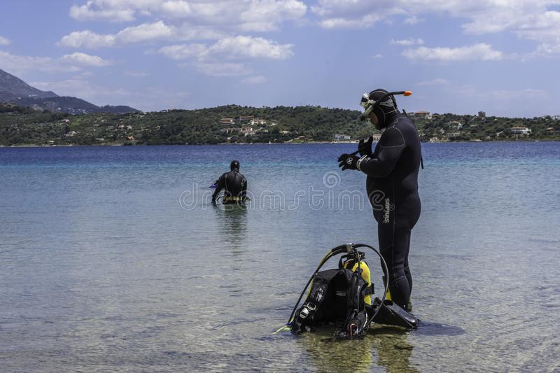 PELOPONESSE, GREECE, APRIL 21, 2018 :A group of divers preparing royalty free stock image