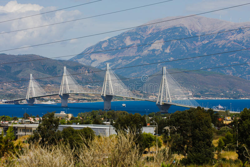 The Peloponnese Bridge. The Rio–Antirrio bridge Greece, officially the Charilaos Trikoupis Bridge after the statesman who first envisaged it, is one of stock photo