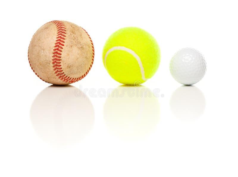 Pelota de golf del béisbol, del tenis y en blanco fotos de archivo