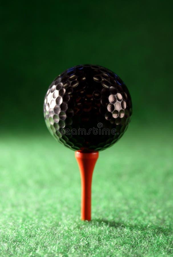 Pelota de golf negra imágenes de archivo libres de regalías