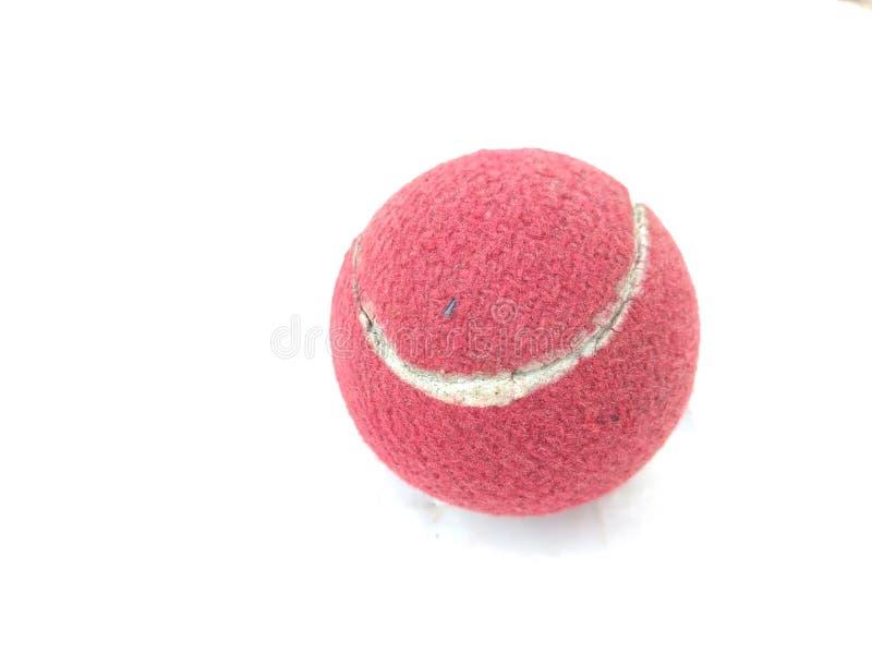 Pelota de tenis coloreada rojo usada imágenes de archivo libres de regalías