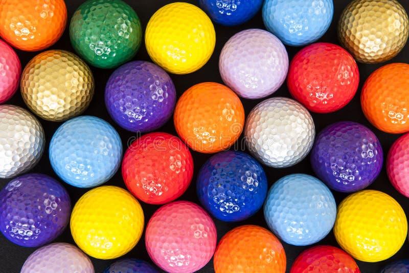 Pelotas de golf coloridas fotografía de archivo