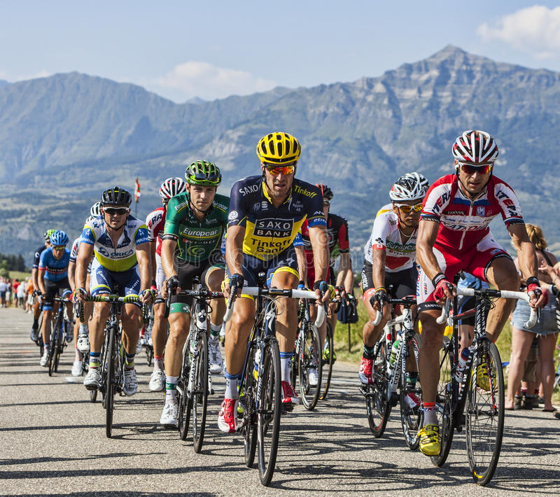 Download The Peloton in Alps editorial stock image. Image of road - 32481459