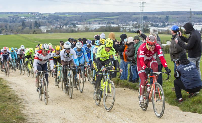 Download The Peloton On A Dirty Road - Paris-Nice 2016 Editorial Stock Photo - Image: 88692453