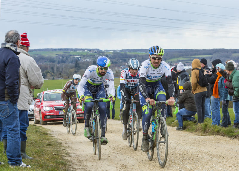 The Peloton on a Dirty Road - Paris-Nice 2016 royalty free stock photo