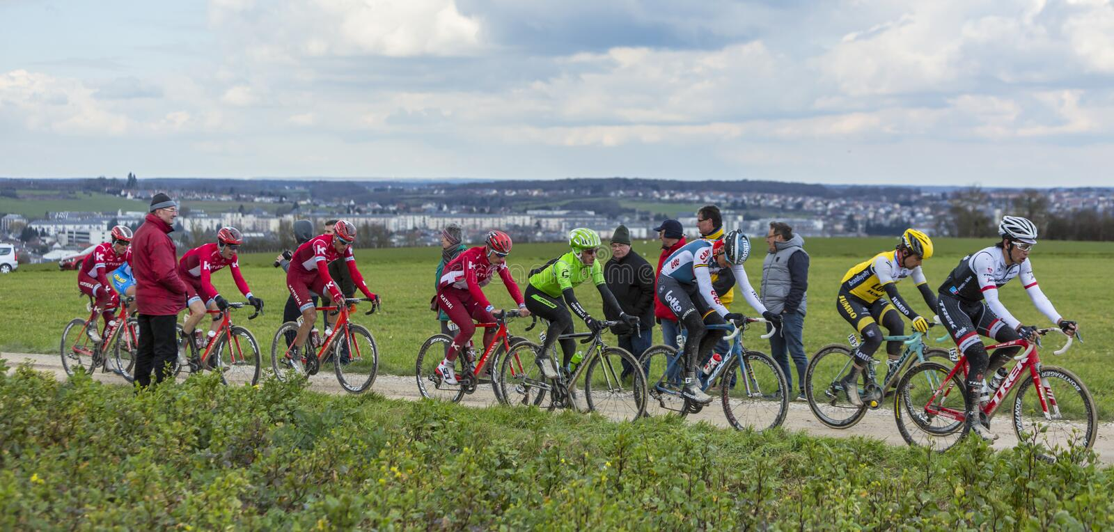 The Peloton on a Dirty Road - Paris-Nice 2016 royalty free stock images