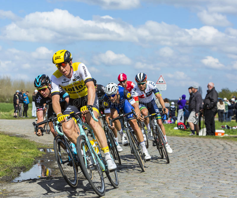 The Peloton - Paris Roubaix 2016. Hornaing ,France - April 10,2016: The Belgian cyclist Tom Boonen of Etixx-Quick Step Team riding in the peloton on a paved road stock images