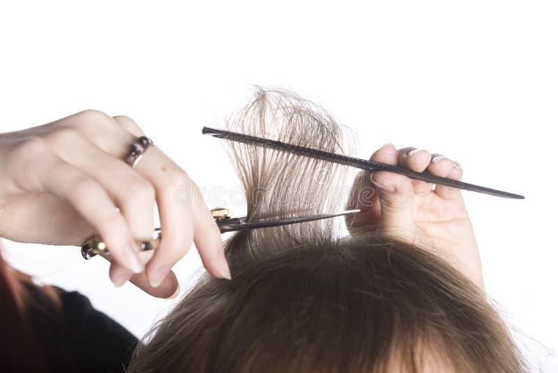 Peluquero Hands Cutting Hair de un cliente foto de archivo libre de regalías