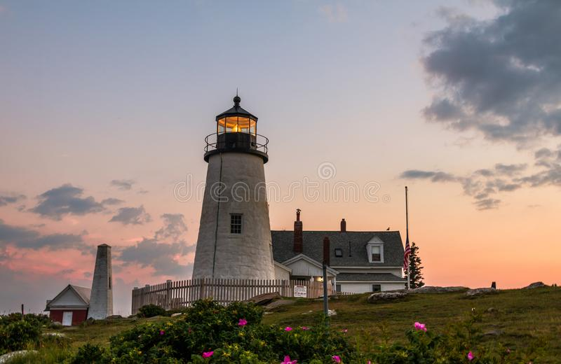 Pemaquid Point Lighthouse at sunset during a calm summer evening in Bristol, Maine. Pemaquid Point Lighthouse at sunset during a calm summer evening in Bristol royalty free stock photos