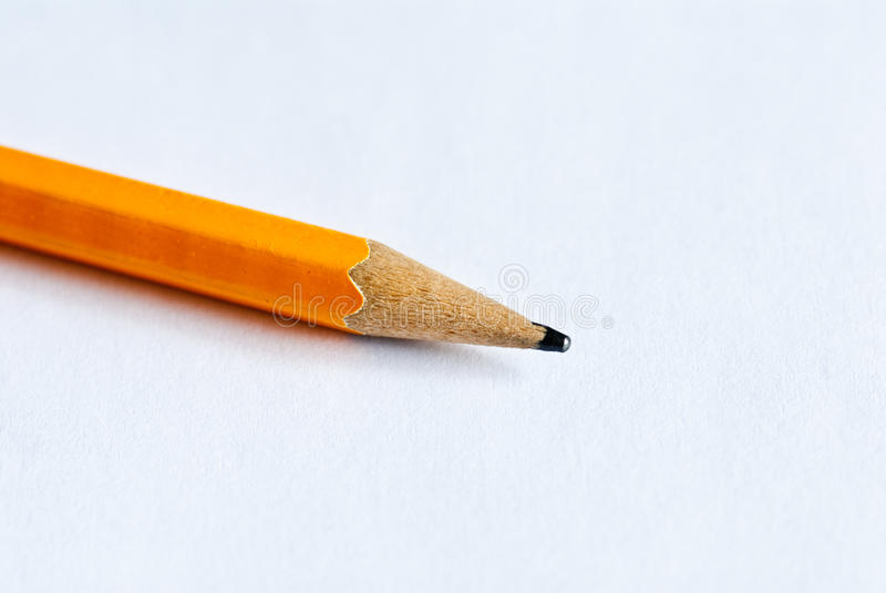 Pen. Yellow pencil, and sharpened stock images