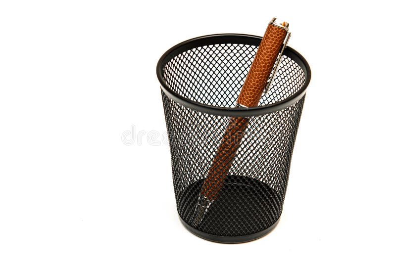 Pen in a black pencil holder on white. royalty free stock images