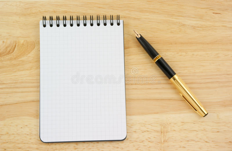 Pen And Blank Note Pad Royalty Free Stock Photography