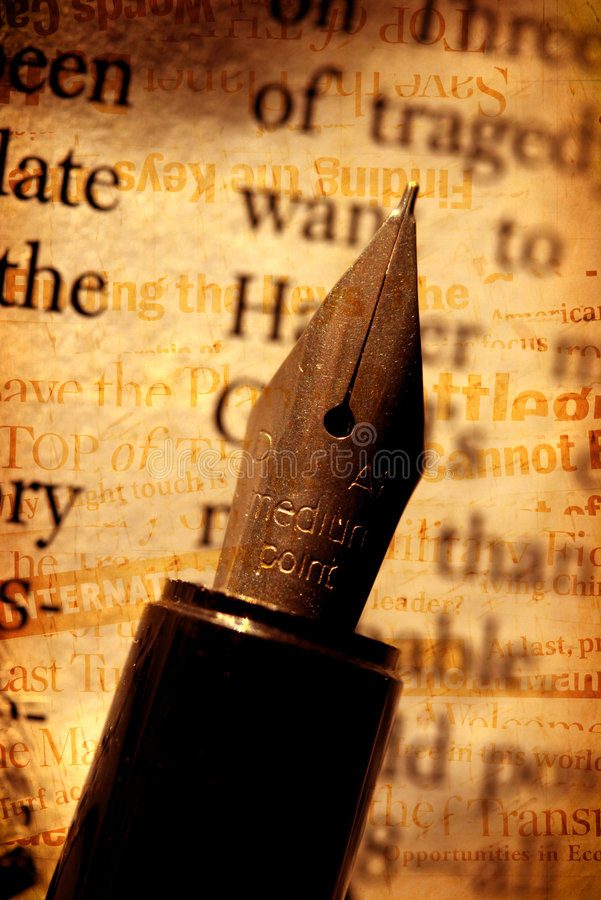 Pen with book. Old fashioned fountain pen with book royalty free stock images