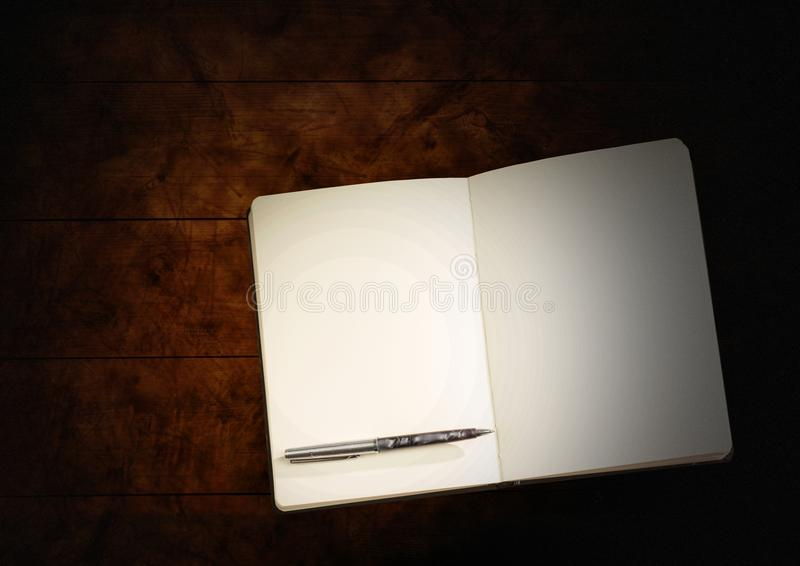 Pen and book with blank pages open on wood. Digital composite of Pen and book with blank pages open on wood royalty free stock images