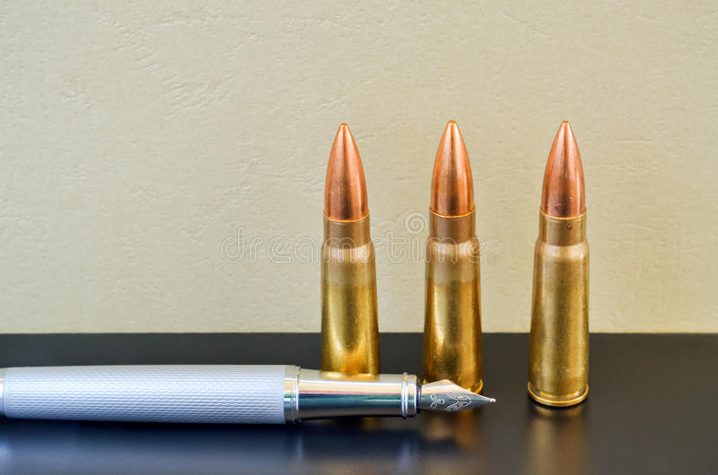Pen and bullets royalty free stock photo