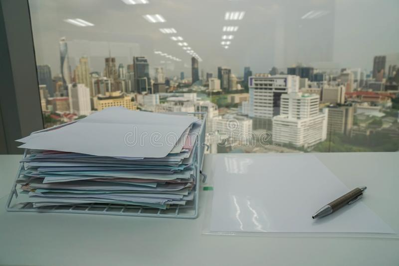 Pen on business documents with stack of report for verification and approval stock photo