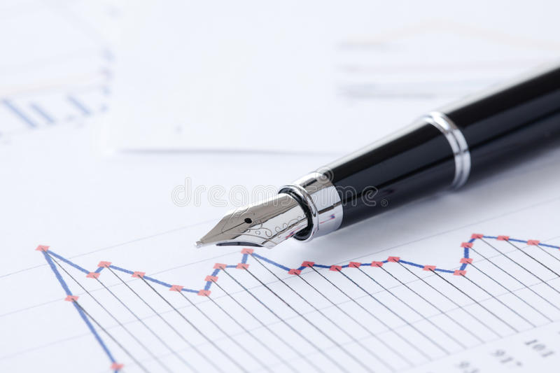 Pen and business graph. Photo shot of pen and business graph royalty free stock image