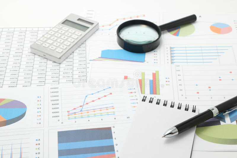Pen, business items, and business documents with numbers and charts. Concept of workplace of the businessman stock photo