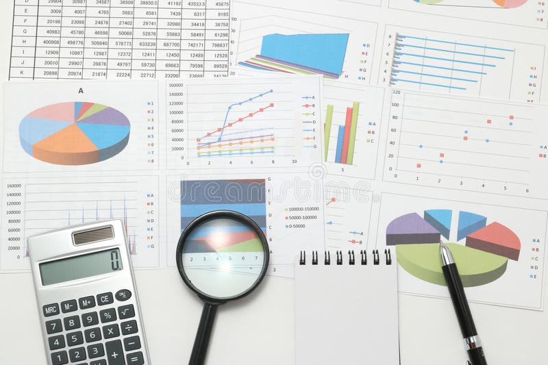 Pen, business items, and business documents with numbers and charts. Concept of workplace of the businessman royalty free stock images