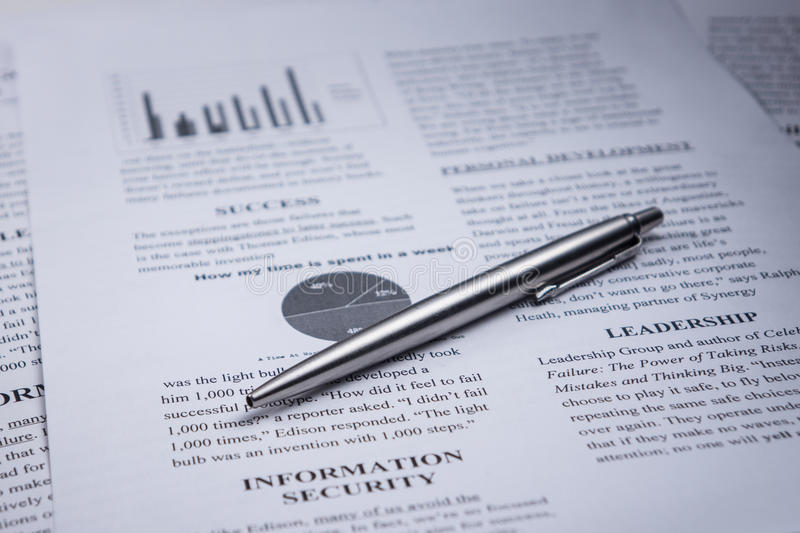A pen on business text and word leadership and information security stock photography