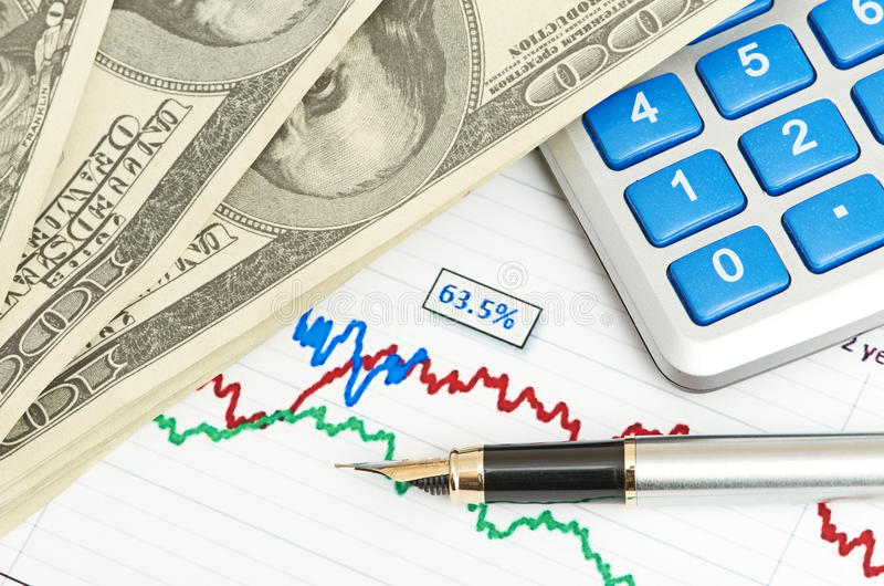 Download Pen,calculator And Dollars On Chart Closeup Stock Photo - Image: 26319724